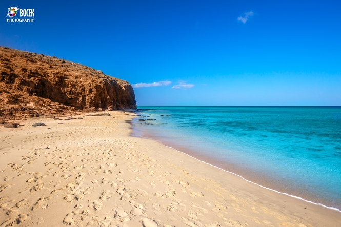 Sandy beach with vulcanic mountains on Fuerteventura island, Can