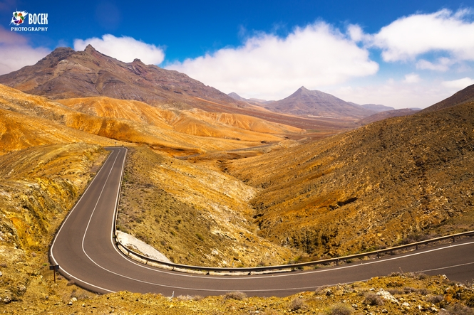 Road leading through the vulcanic mountains of Fuerteventura Isl